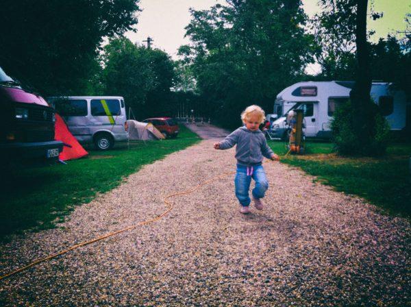Girl Running in Campsite